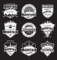 mountain travel white emblems on dark vector image