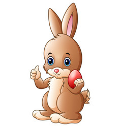 cute little bunny giving a thumb up with holding r vector image