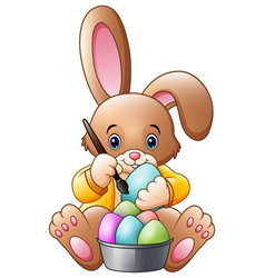 Cartoon rabbit painting an eggs vector