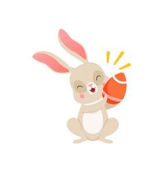 cute cartoon bunny with egg funny rabbit vector image