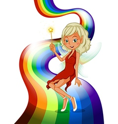 A rainbow with a pretty fairy vector image