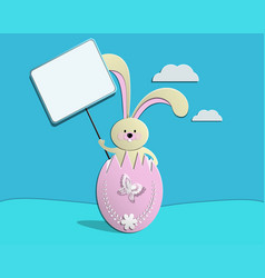 easter bunny sitting in a broken egg and holding a vector image