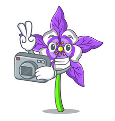 Photographer columbine flower mascot cartoon vector
