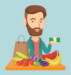 man standing at the table with shopping bag vector image vector image