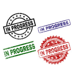 grunge textured in progress seal stamps vector image