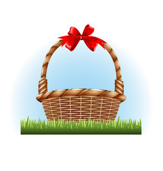empty basket with a red bow standing on grass vector image