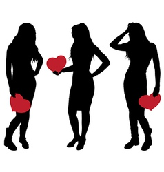 Silhouette of a Girl Holding a Heart vector image