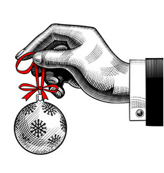 hand of man holding a christmas tree ball vector image