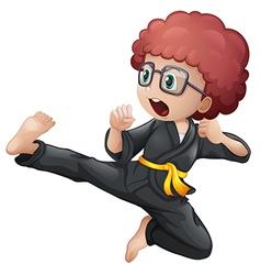 A kid doing karate vector image