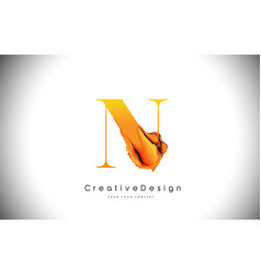 n orange letter design brush paint stroke gold vector image