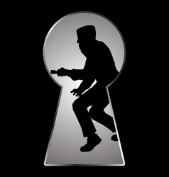 Silhouette of a thief seen through a keyhole vector