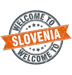 Welcome to slovenia orange round ribbon stamp vector
