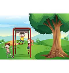 Kids playing near the tree vector image
