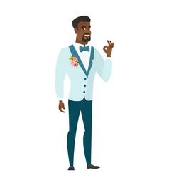 smiling groom showing ok sign vector image