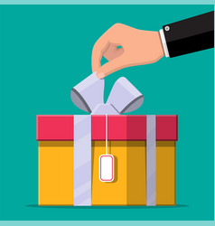 hand opens gift box unboxing unpacked vector image