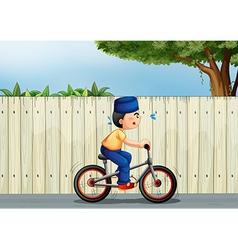 A tired boy biking vector