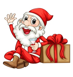 Santa sitting beside a gift vector image