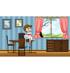 A boy sitting at the table with his cat vector
