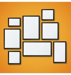 blank picture frame set on orange wall vector image vector image