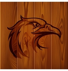 Eagle head vintage logo on realistic brown wood vector