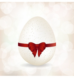 white speckled egg and red ribbon background vector image vector image