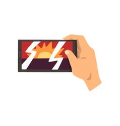 Hand making smartphone photo of sunset snapshot vector