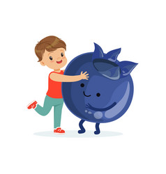 happy boy having fun with fresh smiling blueberry vector image