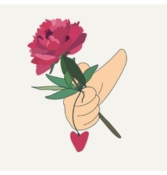 Hand holding a red flower vector