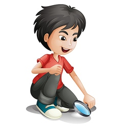 A boy and a magnifier vector image