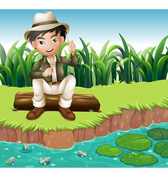 A boy sitting on a wood at the riverbank vector image