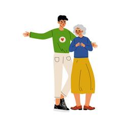male volunteer helping old lady social worker vector image