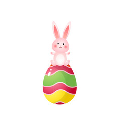 cute rosy easter bunny on top of big painted egg vector image