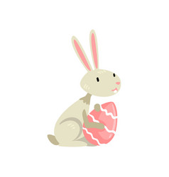 cute white easter bunny with colored egg funny vector image
