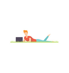 Young man lying on the grass with laptop remote vector