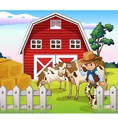 A cowboy inside the farm with cows and a barnhouse vector