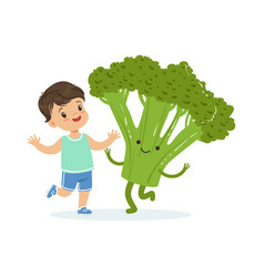happy boy having fun with fresh smiling broccoli vector image vector image
