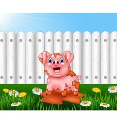 Cartoon funny pig playing in the mud vector