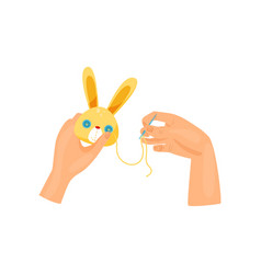 Female hands making soft toy using needle top vector