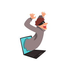 hacker in mask getting out of laptop screen vector image