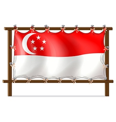 The flag of Singapore attached to the wooden frame vector image