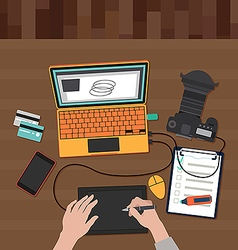 Photographer working on a laptop vector image vector image