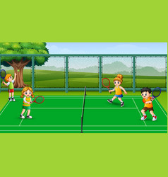 Happy kids playing tennis at the courts vector
