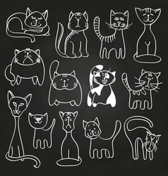 Hand drawn doodle cats set on blackboard vector