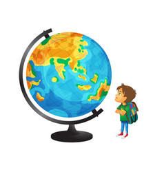 boy with schoolbag looks at big globe vector image