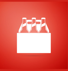 pack of beer bottles icon on red background vector image