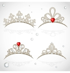 Set openwork jewelry tiaras with diamonds and vector