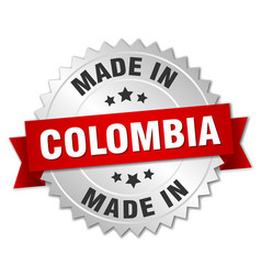 made in colombia silver badge with red ribbon vector image