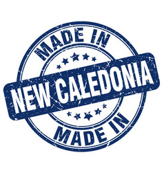 made in new caledonia blue grunge round stamp vector image