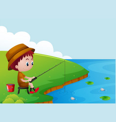 Little boy fishing by the river bank vector