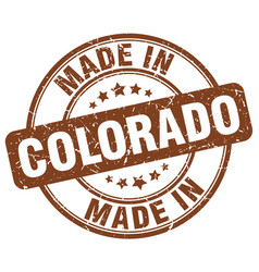 made in colorado brown grunge round stamp vector image vector image
